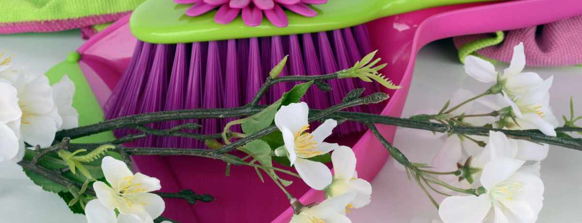 dust pan with flowers to represent green cleaning