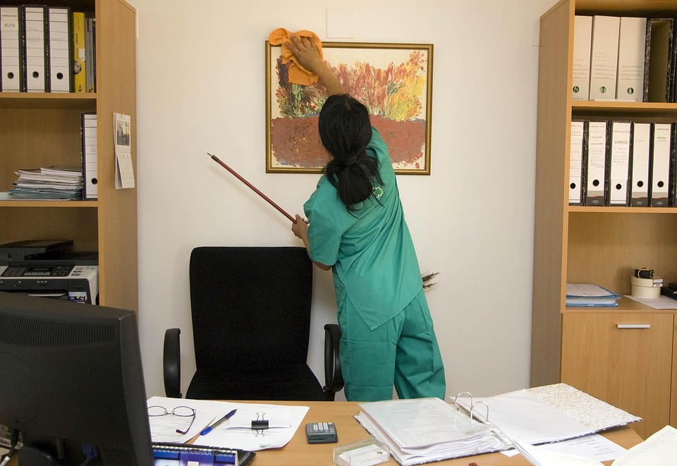 MCA janitor cleaning office in commercial building GTA